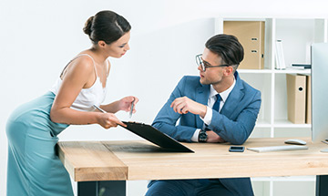 How to Tell If a Female Coworker Likes You: Top 10 Signs
